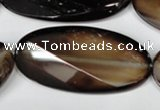 CAG3091 15.5 inches 25*50mm faceted oval black line agate beads