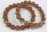CGB4609 10mm - 11mm round golden rutilated quartz beaded bracelets