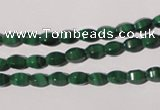 CMN222 15.5 inches 4*6mm faceted rice natural malachite beads