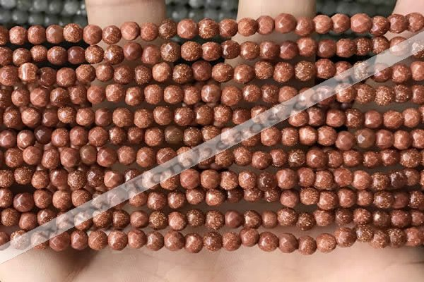 CTG3590 15.5 inches 4mm faceted round goldstone beads wholesale